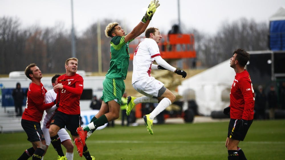 Sophmore A.J. Palazzolo and Maryland junior goalkeeper Dayne St. Clair go for the ball Nov. 9 at Grand Park during the Big Ten men's soccer tournament. Palazzolo has scored four goals throughout the season.