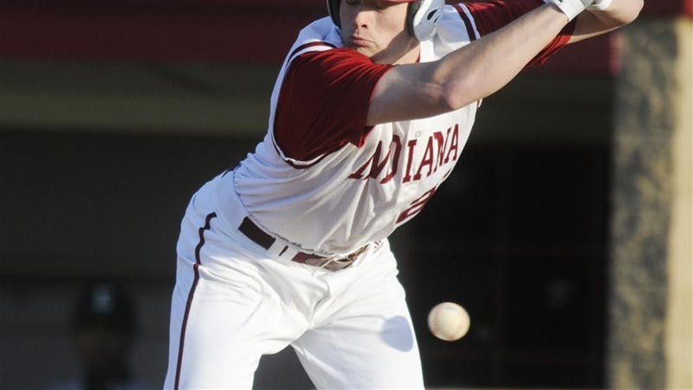 IU freshman catcher Josh Lyon jumps back from a close inside pitch during IU's 10-6 loss to Eastern Michigan on Wednesday evening at Sembower Field.