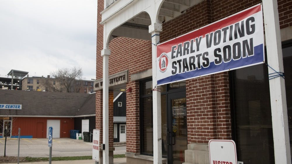 An early voting sign hangs April 4, 2019, at Monroe County Election Central. A new Indiana bill would extend voting hours to 6 a.m. to 8 p.m. on Election Day.