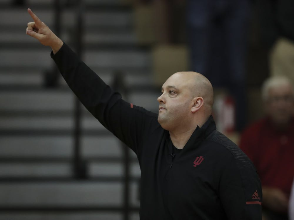 IU volleyball Head coach Steve Aird instructs the team Sept. 21, 2018, at the game against Northwestern University at University Gym. IU finished the 2019 season with an overall record of 14-19.