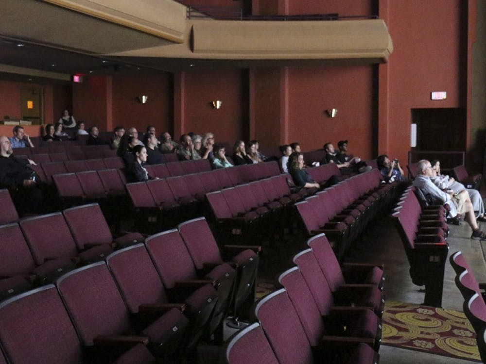 Media representatives watched a moive following the talk about the installation of new equipment at the Buskirk-Chumley Theater Wednesday evening.