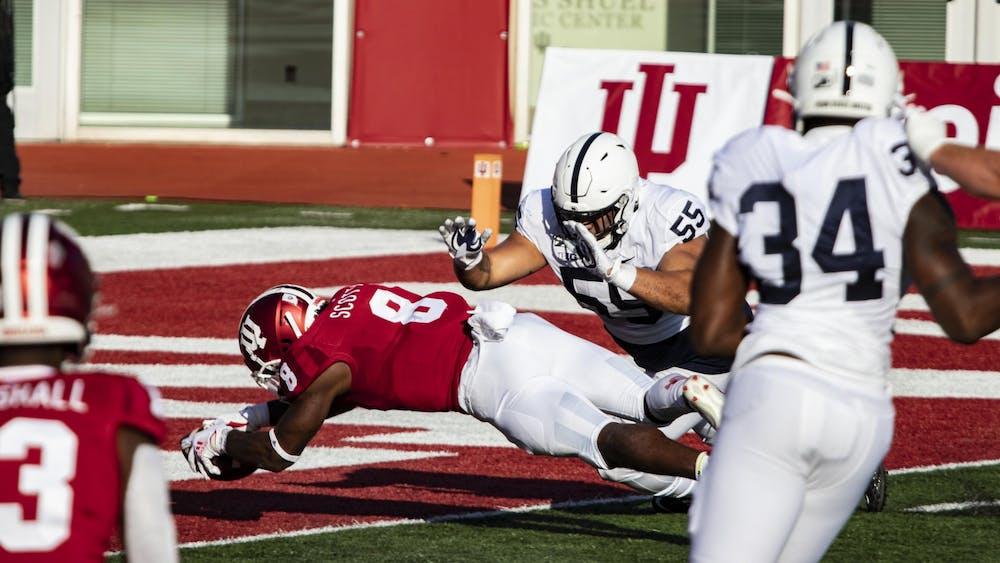 Junior running back Stevie Scott III scores a touchdown Oct. 24 in Memorial Stadium. No. 13 IU has kicked off against No. 23 Michigan.