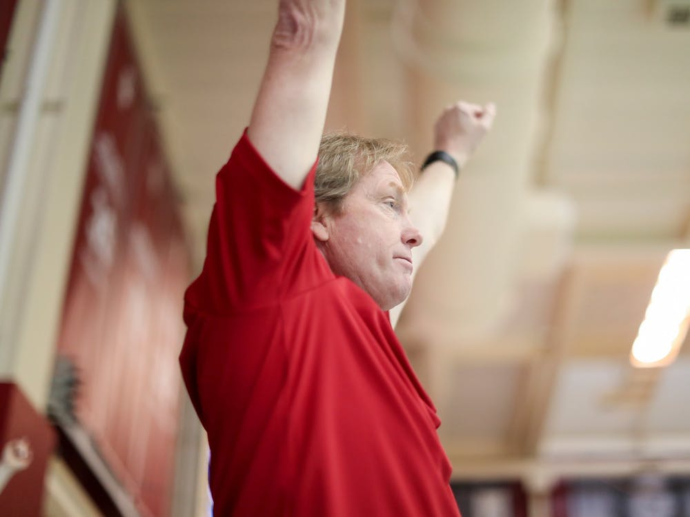 IU swimming head coach Ray Looze raises his arms during the Big Ten Tournament meet Feb. 20, 2019 at Counsilman-Billingsley Aquatic Center in Bloomington. Looze is in his 18th year coaching IU and will be inducted into the ASCA Hall of Fame later this year.