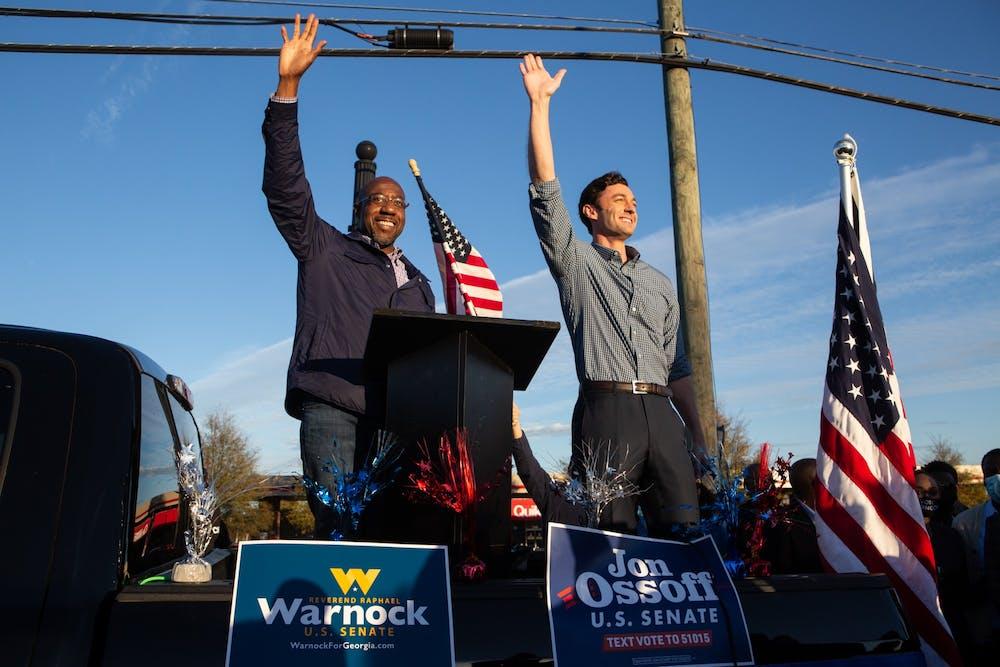 <p>Then-U.S. Senate candidates Jon Ossoff, D-Georgia, and Raphael Warnock, D-Georgia, greet the crowd at a rally on Nov. 15 in Marietta, Georgia. </p>