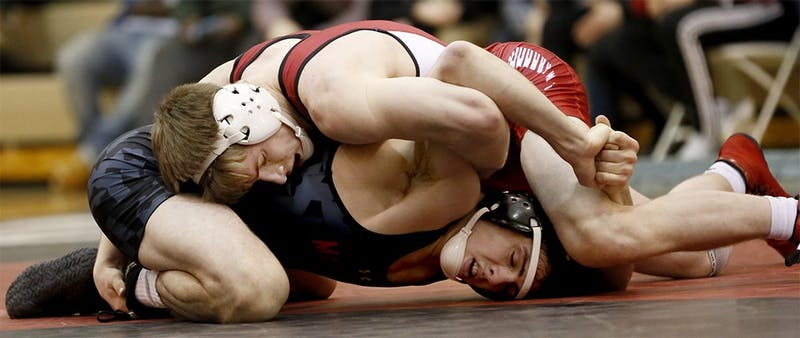 Then-freshman, now senior, Bryce Martin wrestles against Maryland during the 2015-16 season at the University Gym. IU defeated Southern Illinois University Edwardsville 21-15 Friday.