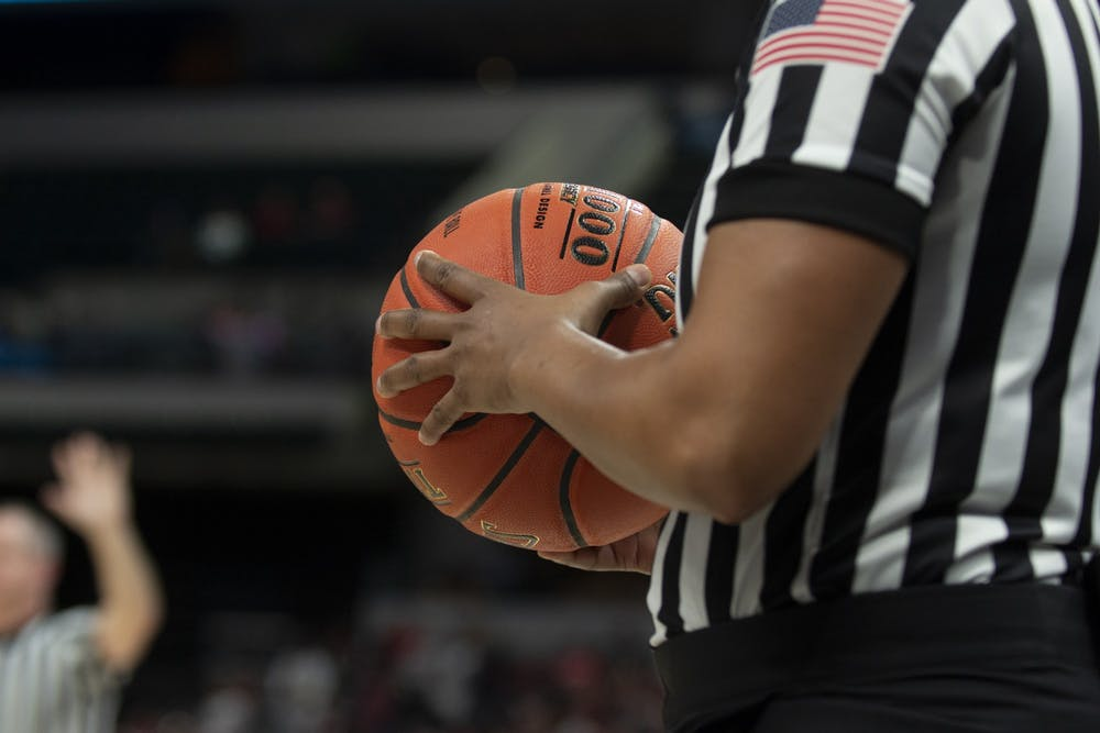 <p>A referee holds a basketball March 6 at Bankers Life Fieldhouse in Indianapolis. IU men&#x27;s basketball team has paused workouts after multiple positive coronavirus cases.</p>