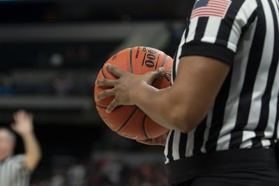 A referee holds a basketball March 6 at Bankers Life Fieldhouse in Indianapolis.