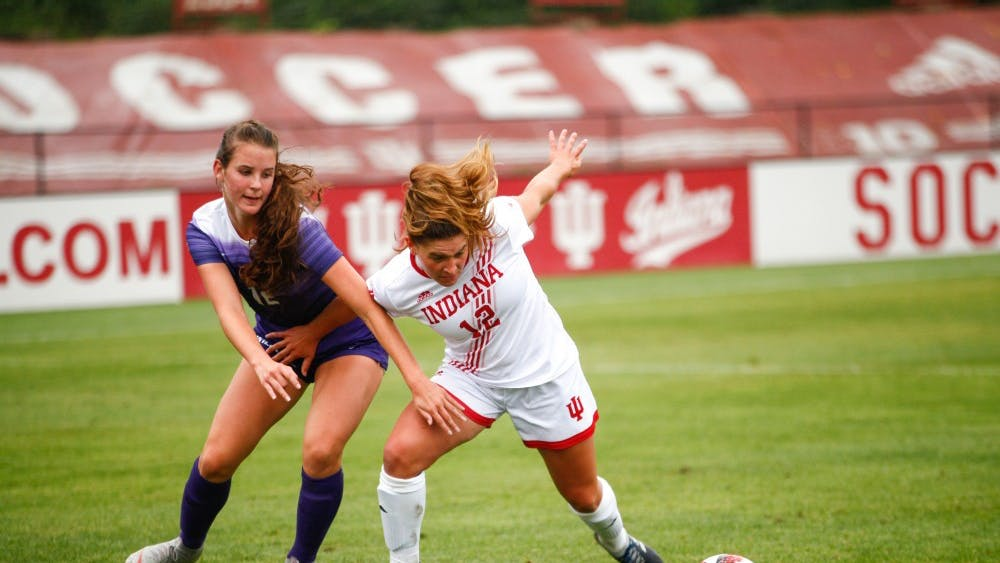 Sophomore Melanie Forbes keeps her opponent behind her as she goes for the ball against Kansas State on Sept. 9 at Bill Armstrong Stadium. IU and Purdue will play for the Golden Boot this weekend.