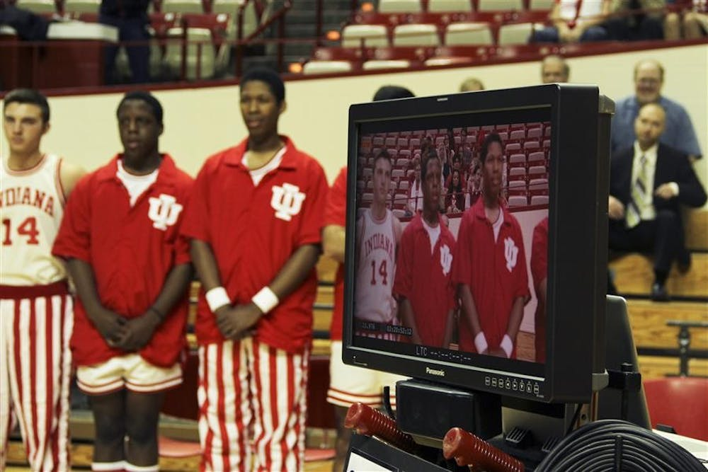 Students wait in position while the crew practices shot during the filming of a commercial Thursday morning at Assembly Hall. The IU promotional commercial, directed by Jo Trockmorton of Blue Ace Media, was filmed from 8 a.m. at various locations on campus.