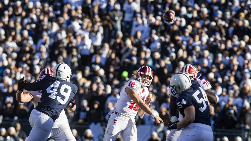 Junior quarterback Peyton Ramsey throws the ball Nov. 16 at Beaver Stadium. IU played against Penn State and lost, 34-27.