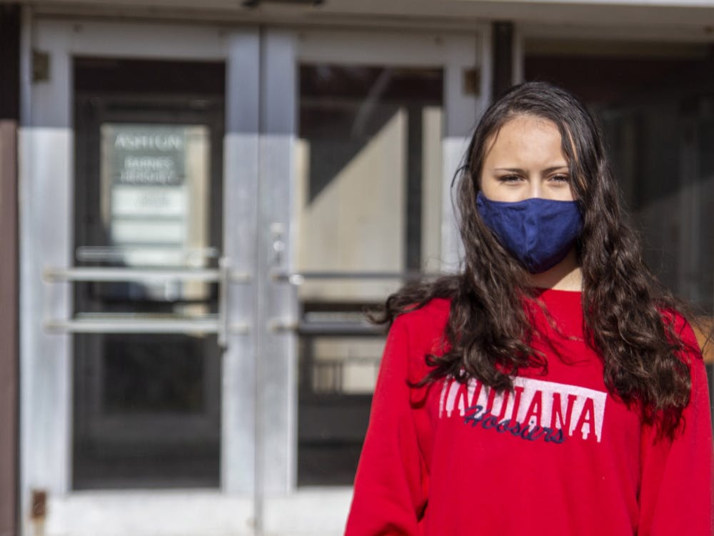 Freshman Maia Law stands Nov. 5 outside of Ashton Residence Center. Law spent time in quarantine at Ashton's contact tracing hall after caring for her sick friends. While there, she saw multiple violations of rules, including students leaving and entering the building to hang out with friends.