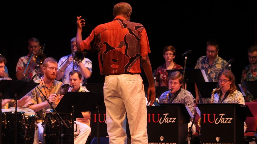 Jacobs School of Music director, Wayne Wallace, conducts the students of the Latin Jazz Ensemble Monday at the Buskirk Chumley Theater. He is a seven-time Grammy nominee teaching the Jacobs students African American Latin music at IU.