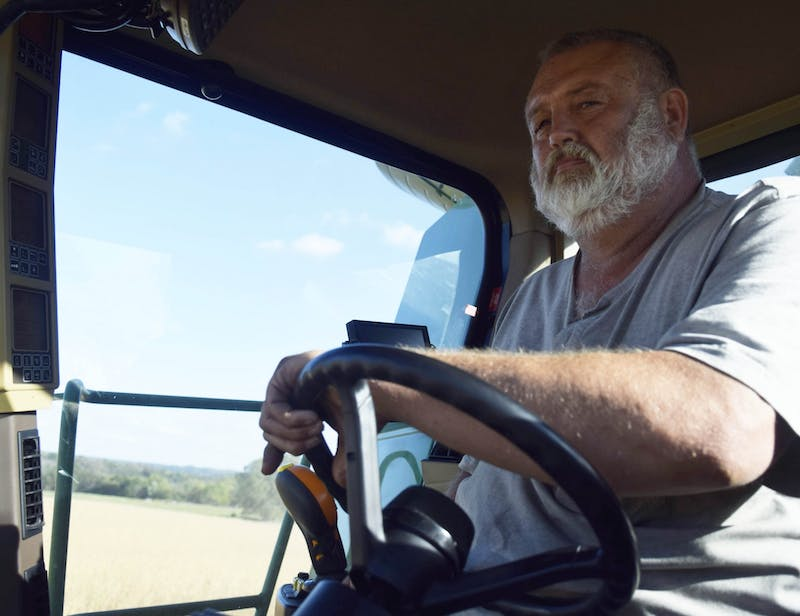 <p>Jeff Deck drives his tractor at his farm near Ellettsville, Indiana. Deck said he wants to know what his father would think about the technology present in modern farming.</p>