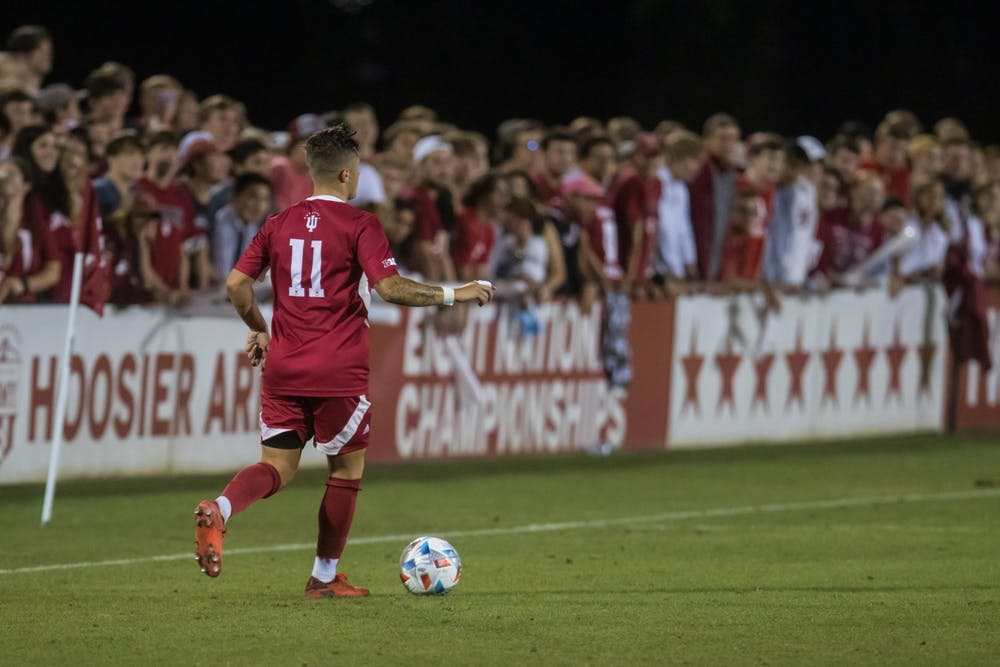 Senior Nyk Sessock dribbles the ball on Sept. 3, 2021, at Bill Armstrong Stadium. Sessock said Indiana is ready to put on a show in its match against Ohio State on Tuesday.
