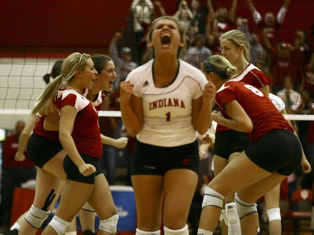 The Hoosier volleyball team celebrates a point en route to a five-set victory over Tennessee on Saturday in University Gym. The Hoosiers are now headed to the Sweet 16 for the first time in program history.