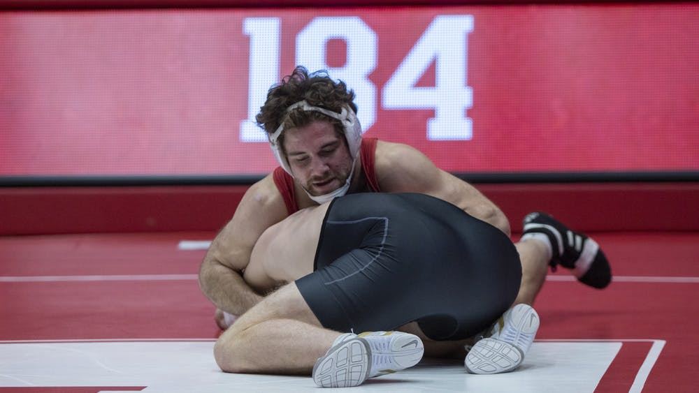 Redshirt senior Jake Hinz goes up against Purdue junior Max Lyon Jan. 20 in Wilkinson Hall. IU lost to Purdue 9-23.