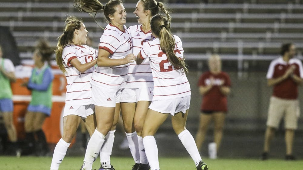 Members of the IU women's soccer team celebrate after scoring its second goal Sept. 2, 2021, in Bill Armstrong Stadium. The Hoosiers scored two goals in the second half.
