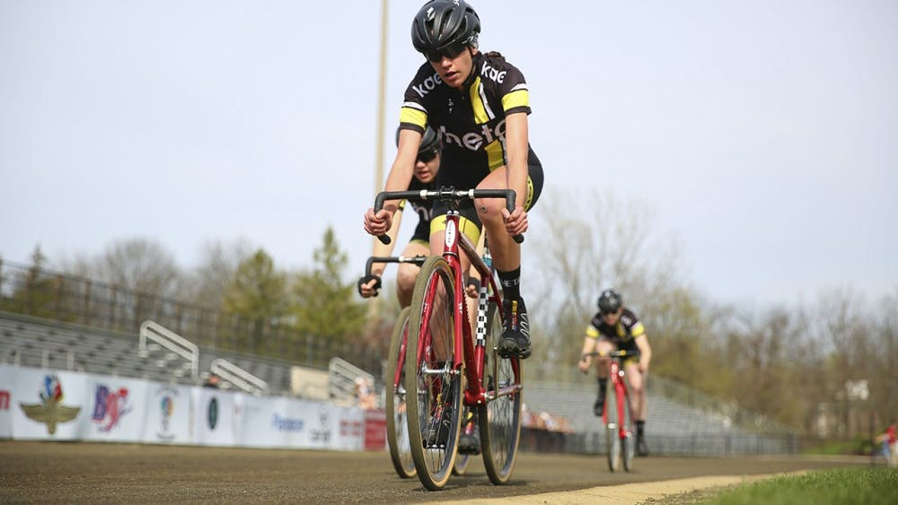 Theta flies into the third turn during Team Pursuit at the Bill Armstrong Stadium.  Theta raced against Delta Gamma during the final event of the spring race series Sunday.