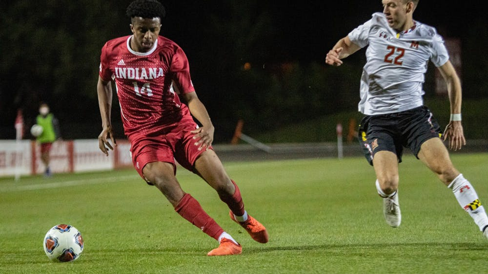 Sophomore forward Maouloune Goumballe plays offense April 14 at Bill Armstrong Stadium. Indiana won 3-1 Sunday in penalty kicks during a game against St. Francis Brooklyn.