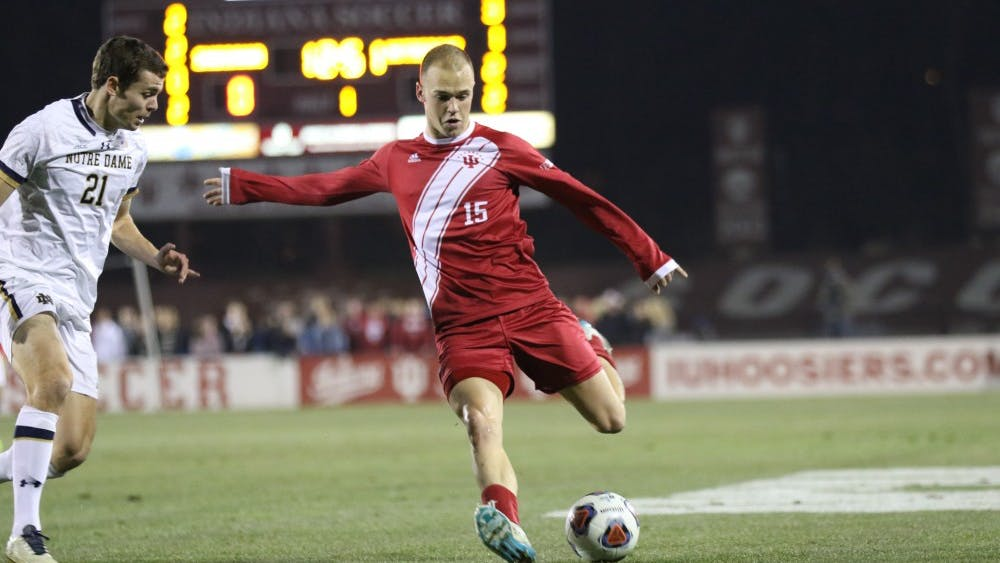 Senior defender Andrew Gutman dribbles up the sideline during the NCAA Tournament quarterfinal against Notre Dame's Thomas Ueland on Nov. 30 at Bill Armstrong Stadium. IU defeated Notre Dame, 1-0.