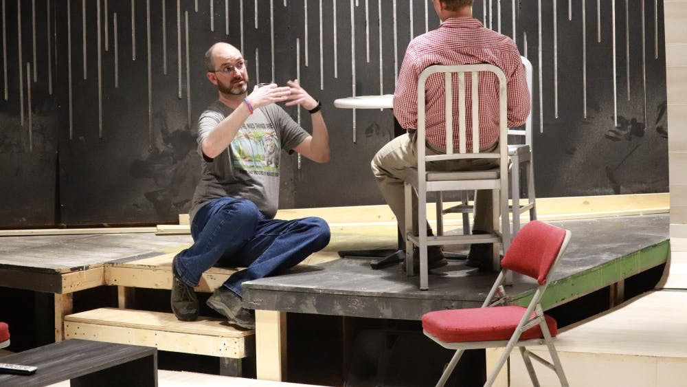 """Actors Paul Daily and Patrick Wiegand rehearse in Bloomington Playwrights Project for the play, """"Apropos of Nothing."""" The play is about a man in love with his best friend's wife."""