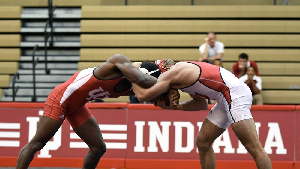 Redshirt freshman Austin Holmes and redshirt freshman Davey Tunon wrestle in the 149 lb weight class in the Cream and Crimson dual on Oct. 26 at the University Gym. IU named Mike Dixon associate head coach on Tuesday.