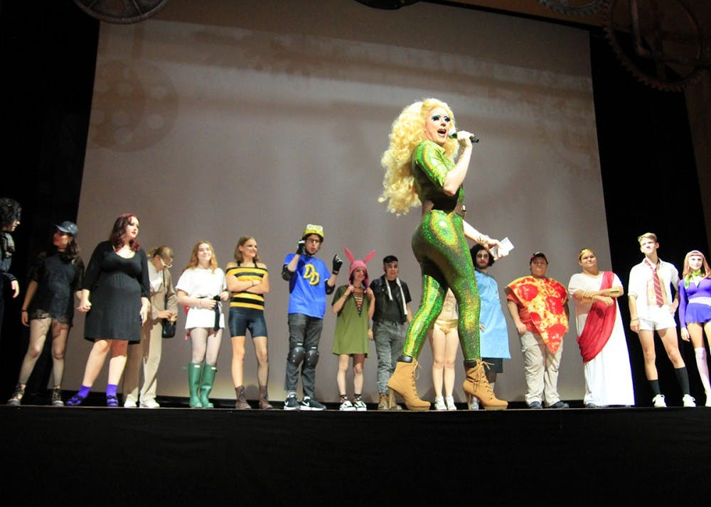 "<p>Local drag queen from The Back Door chooses about 30 people to be a part of a costume contest. The contest was a part of a ""de-virginization"" ritual for newcomers to Rocky Horror Picture Show.</p>"