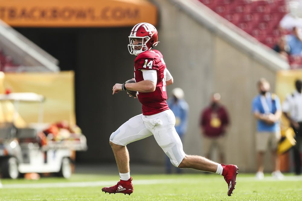 <p>Then-sophomore quarterback Jack Tuttle runs the ball Jan. 2, 2021, at Raymond James Stadium in Tampa, Florida. Indiana football head coach Tom Allen said during a press conference Monday that Tuttle will start in instead of Penix Oct. 16 against Michigan State.</p>