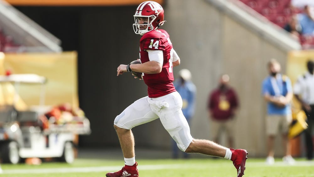 Then-sophomore quarterback Jack Tuttle runs the ball Jan. 2, 2021, at Raymond James Stadium in Tampa, Florida. Indiana football head coach Tom Allen said during a press conference Monday that Tuttle will start in instead of Penix Oct. 16 against Michigan State.