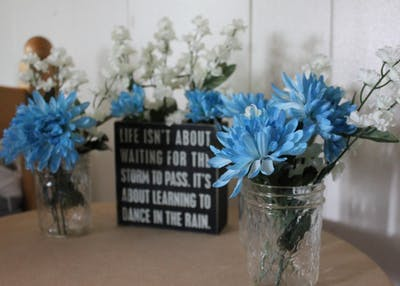 Flower jars are cheap, easy and beautiful. Fake flowers are often on sale at craft stores, and a wide variety of colors lets you pick styles based on the season or room color scheme.