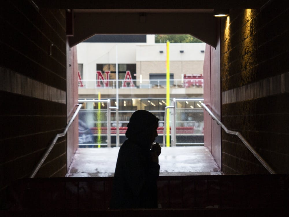 A student walks in front of a tunnel while submiting a saliva sample for COVID-19 mitigation testing Oct. 15 at Memorial Stadium. Both Memorial Stadium and Simon Skjodt Assembly Hall were used as sites for mitigation testing in the fall semester, in addition to a site at Franklin Hall.