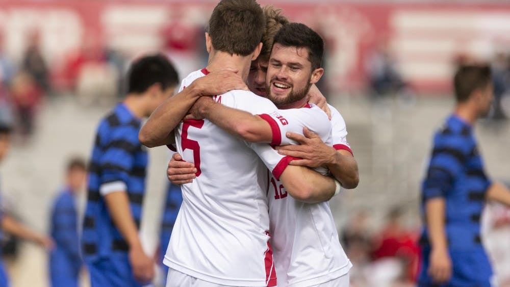 Senior defender Timmy Mehl, sophomore midfielder Justin Rennicks and senior midfielder Austin Panchot celebrate after Mehl scored a second goal against the Air Force on Nov. 25 at Bill Armstrong Stadium during the third round of the NCAA Tournament.