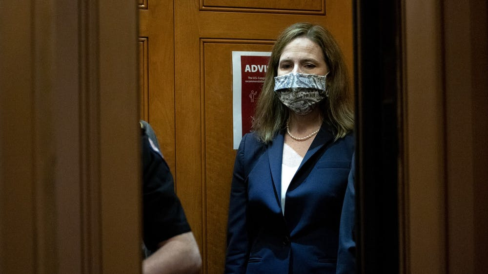 Supreme Court nominee Judge Amy Coney Barrett departs the U.S. Capitol on October 21 in Washington, D.C. The Senate confirmed Barrett's nomination with a vote of 52-48.