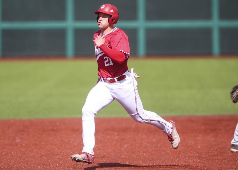 Freshman infielder Elijah Dunham runs to third base March 30 at Bart Kaufman Field. Baserunning mistakes have cost the Hoosiers during their recent losing streak.