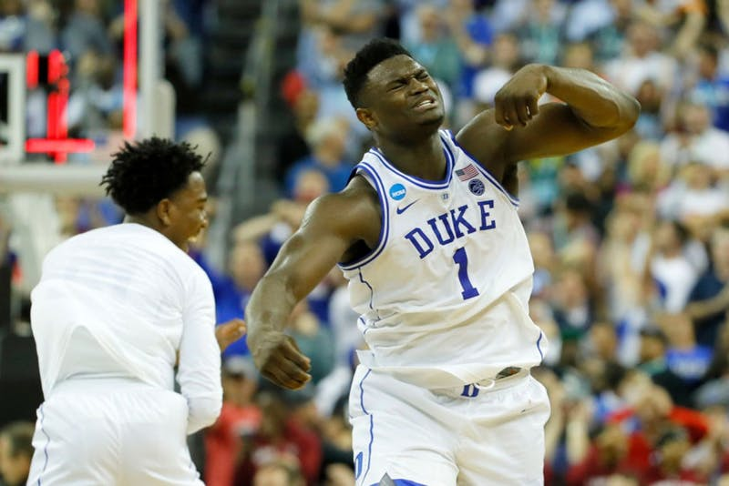 Zion Williamson of the Duke Blue Devils celebrates with his teammates after defeating the University of Central Florida Knights on March 24 in the second round game of the 2019 NCAA Men's Basketball Tournament.