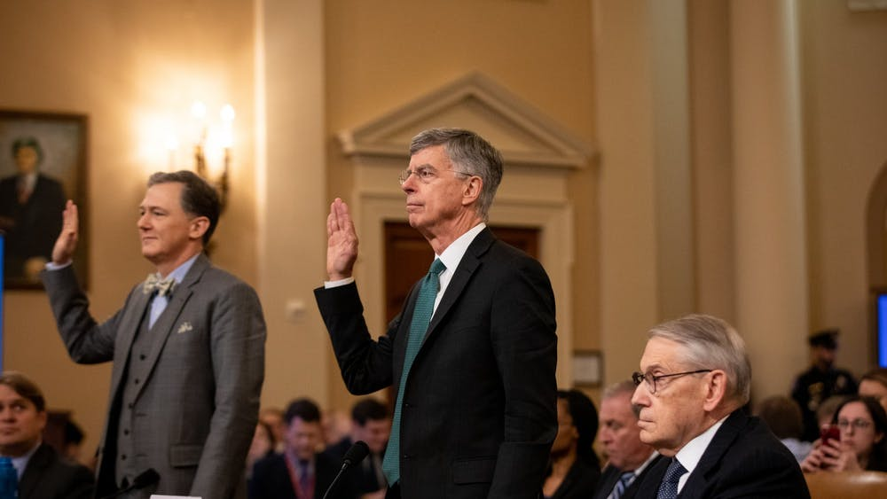 Deputy Assistant Secretary for European and Eurasian Affairs George Kent, left, and William B. Taylor, right, swear in to the House Intelligence Committee's first public inquiry into the interaction between President Donald Trump and the government of Ukraine on Nov. 13 at the U.S. Capitol in Washington, D.C.