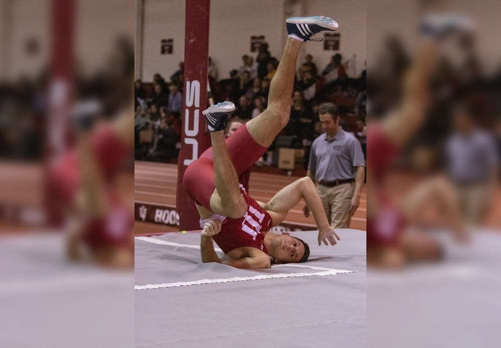 <p>Senior pole vaulter Adam Coulon lands in the pit after finishing his vault Jan. 24 in Gladstein Fieldhouse. IU will compete in the Meyo Invitational on Feb. 7-8 in South Bend, Indiana. </p>