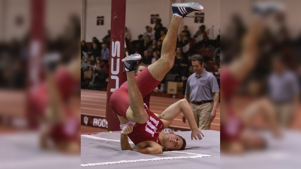Senior pole vaulter Adam Coulon lands in the pit after finishing his vault Jan. 24 in Gladstein Fieldhouse. IU will compete in the Meyo Invitational on Feb. 7-8 in South Bend, Indiana.