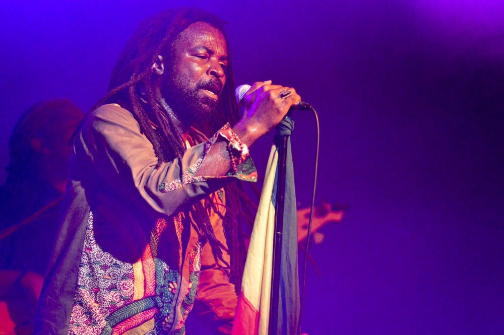 """Grammy nominee Rocky Dawuni served as the main attraction with his Afro Roots and Reggae sound at this year's Lotus World Music & Arts Festival held this weekend throughout downtown Bloomington. The festival contained 8 venues, over 30 International Artists, and as the headline states """"1 Unforgettable Experience""""."""