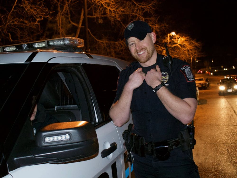 IUPD Lt. Nick Lewis, 33, stopped outside Alpha Epsilon Pi fraternity early Friday morning. Lewis patrolled campus March 1, the day the ban on social activities at fraternities was lifted.