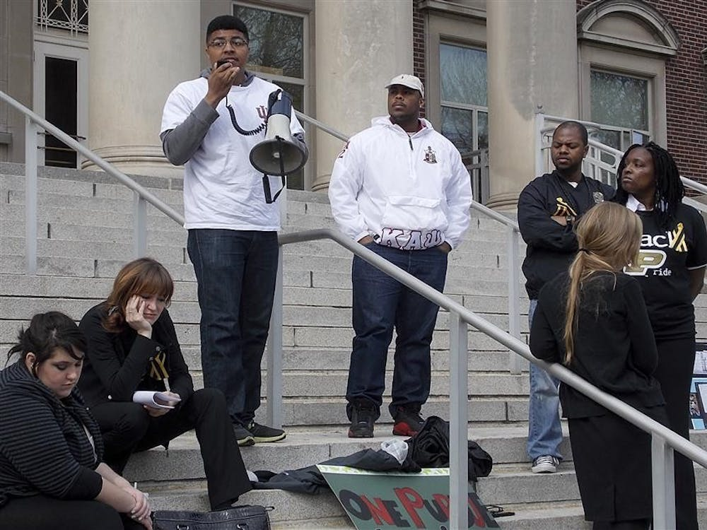 IU juniors Leighton Johnson and Brandon Washington speak to the crowd gathered about their support for the Purdue community's need for diversity Friday on the steps of Hovde Hall at Purdue University.