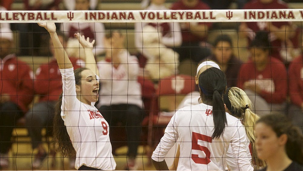 Members of the IU volleyball team celebrate after a point is scored during their game against Rutgers on Nov. 12 in University Gym.