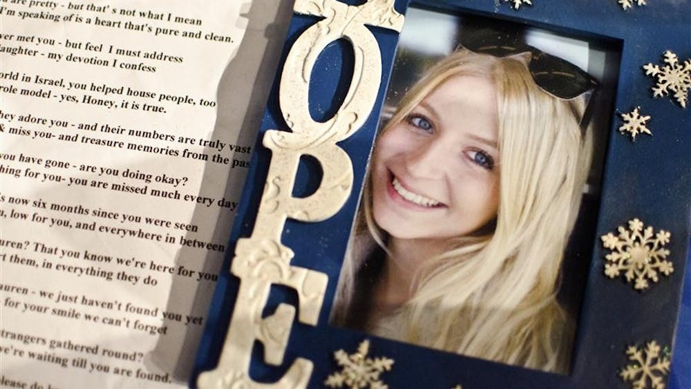 A picture of missing IU student Lauren Spierer sit next to a poem dedicated to the search for her at a prayer and support event in 2011. Thursday marked 10 years since Spierer's disappearance.