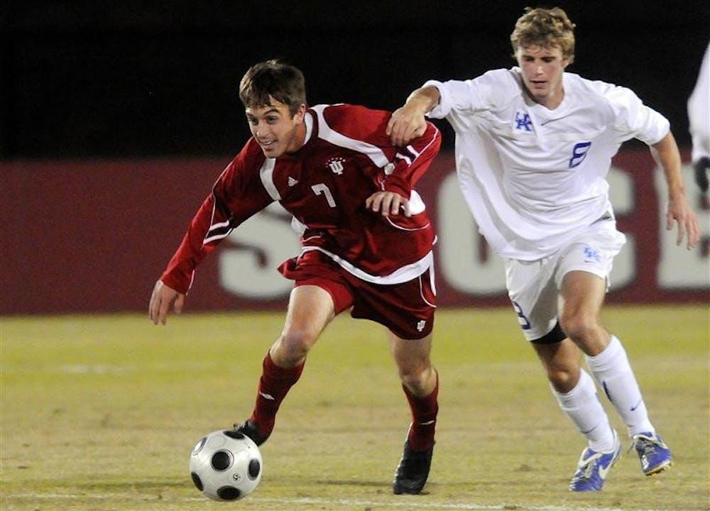 IU junior midfielder Eric Alexander, left, steals the ball from Kentucky defender Jason Griffiths during a soccer game Wednesday night at Bill Armstrong Stadium.