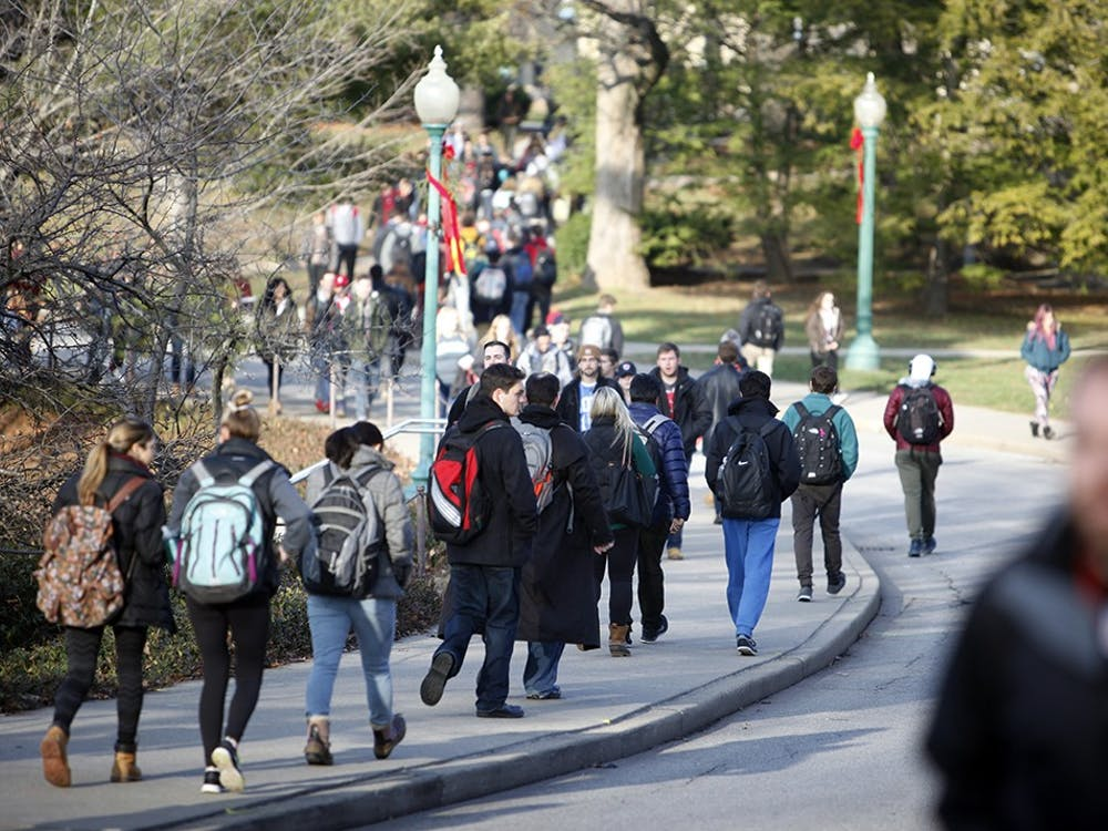 IU students walk on campus between classes. John Wilkerson, executive director of international admissions, said intent to enroll numbers for international students for the fall semester have dropped about 13%.