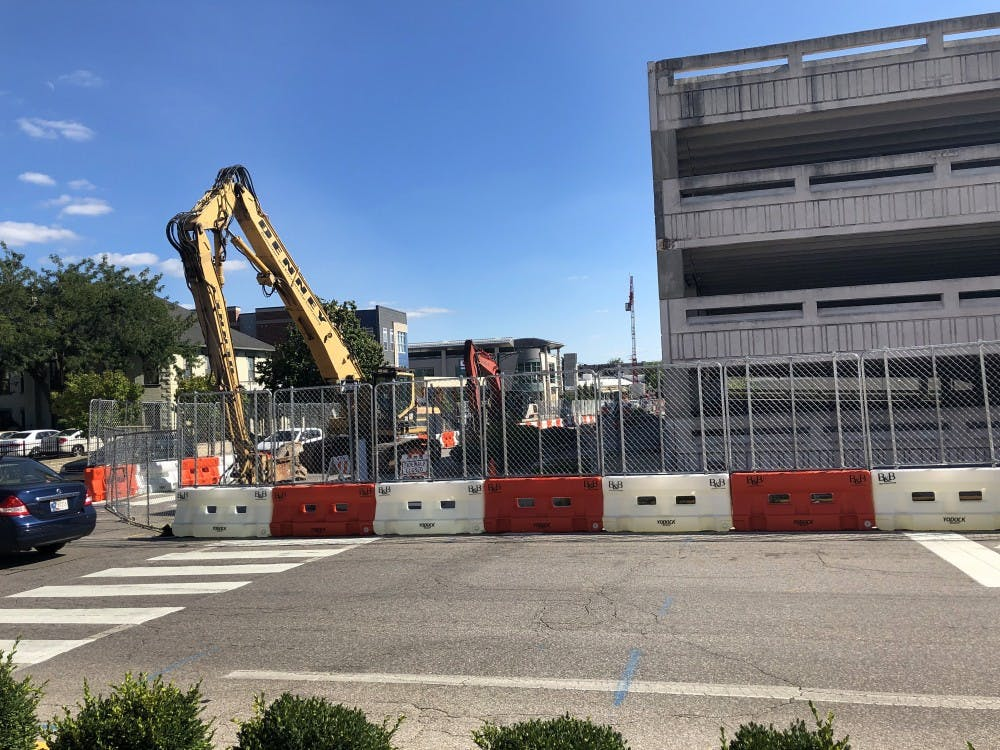 <p>Heavy machinery sits idle Sept. 5 next to the Fourth Street parking garage. The garage was closed for structural repairs Jan. 2.</p><p></p>