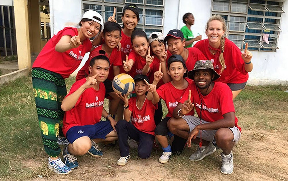 Derrick Morgan (bottom right) traveled to Vietnam this past summer in a program called Coach for College (CFC). CFC use American athletes to help promote the importance of academics in the lives of children between the ages of 11 and 14.