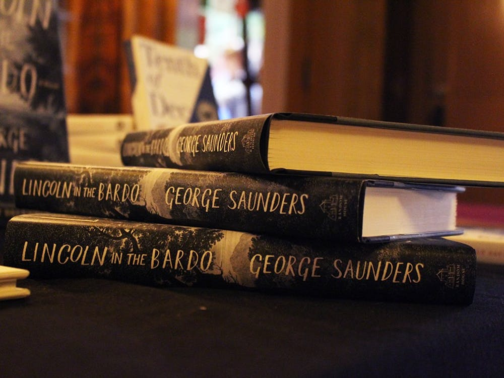 """George Saunders' recently published novel""""Lincoln in the Bardo"""" was sold by Boxcar Books during Tuesday's event. Saunders signed books after his talk at the Buskirk-Chumley Theater."""