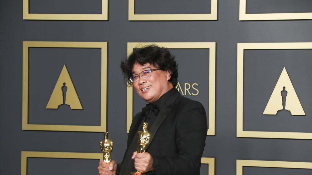 "Director Bong Joon-ho poses in the photo room at the 92nd Academy Awards Feb. 9 at the Dolby Theatre in Hollywood, California. His film, ""Parasite"", was the winner of the International Feature and Best Picture Oscar."