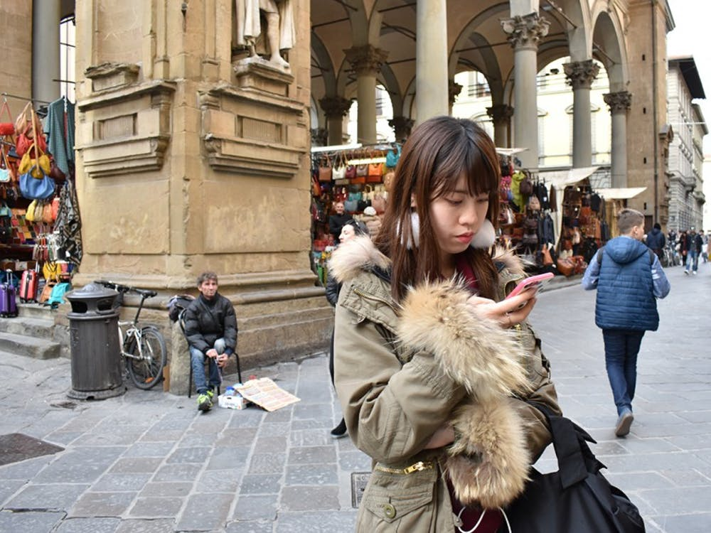 While wandering through Florence, tourists are often caught up in capturing moments rather than experiencing them.